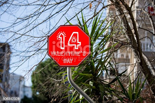 507397624istockphoto Valentine´s day Sign at city street 506342328