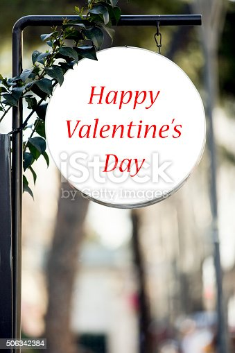 507397624istockphoto Valentine´s day Sign at city street 506342384