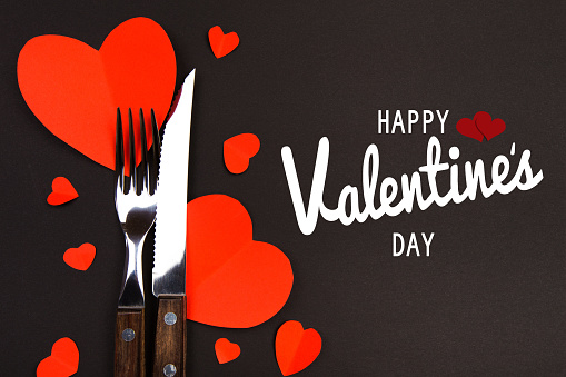 Valentines day table setting with  knife, fork and hearts/ Holidays background/ Valentines day background - Image