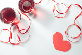 istock Valentine's Day. Two glasses with red wine and gifts. Top view 907867082