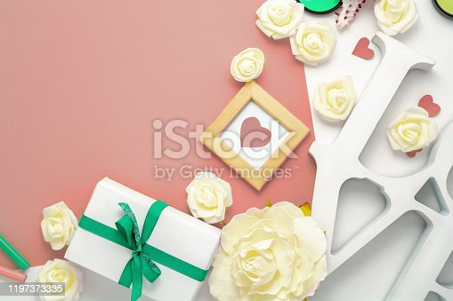 825251738 istock photo Valentines day, wedding, engagement flat lay, top view. Present gift box, ribbon, hearts, rose flowers, Love, pink paper 1197373335