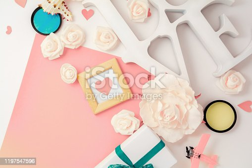 825251738 istock photo Valentines day, wedding, engagement flat lay, top view. Present gift box, ribbon, hearts, rose flowers, Love, pink paper 1197547596