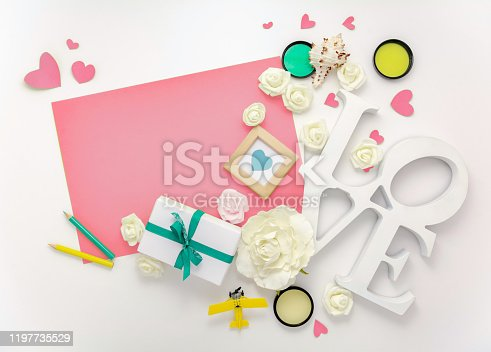 825251738 istock photo Valentines day, wedding, engagement flat lay, top view. Present gift box, ribbon, hearts, rose flowers, Love, pink paper 1197735529
