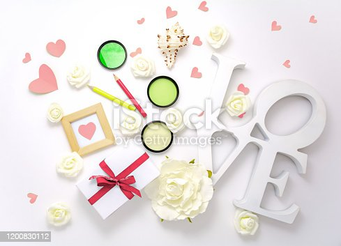 825251738 istock photo Valentines day, wedding, engagement pink flat lay, top view. Present gift box, ribbon, hearts, rose flowers, sign Love 1200830112