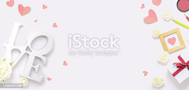 825251738 istock photo Valentines day, wedding, engagement pink flat lay, top view. Present gift box, ribbon, hearts, rose flowers, sign Love 1205401286