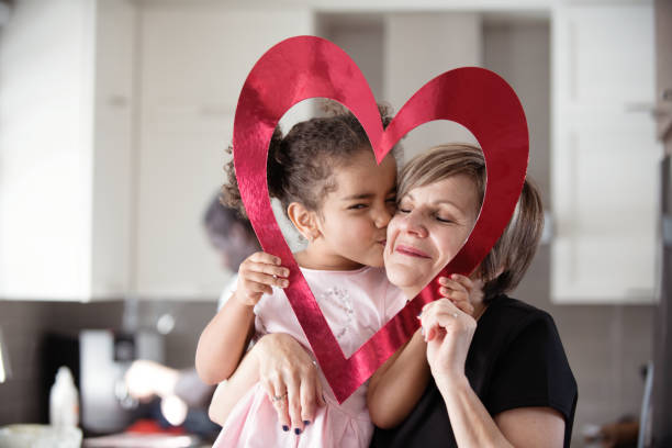 valentine's day with multi-ethnic family - senior valentine stock photos and pictures