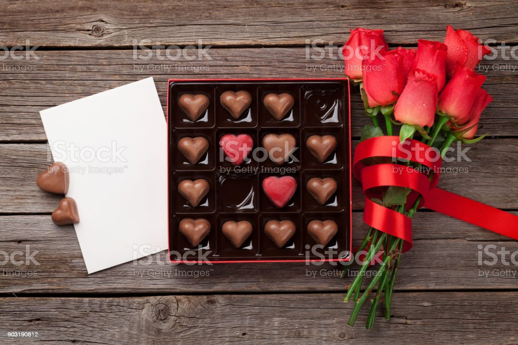 Valentines day with red roses and chocolate stock photo