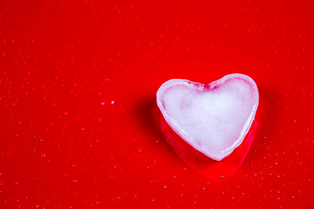 Valentines greeting card with ice heart on red background