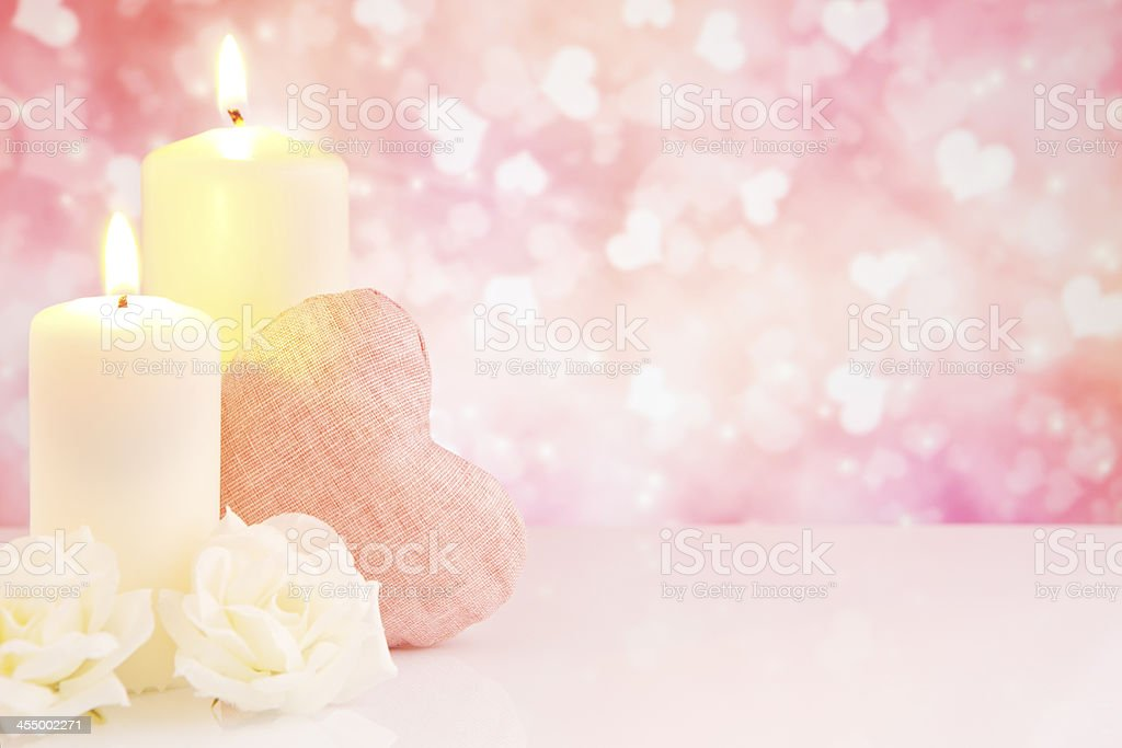 Valentine's hearts and candles with a bright glittering background royalty-free stock photo