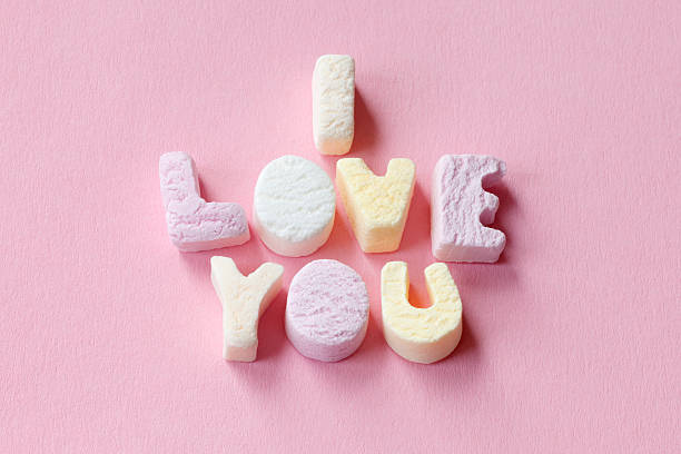 valentines letter candies - i love you stock photos and pictures