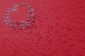 istock Valentine's silhouette of scattered beads on a pink background. 1151826270