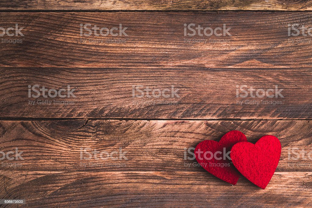 Valentines wooden background with felt hearts. Flat lay. stock photo