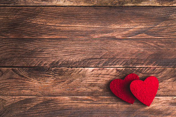 valentines wooden background with felt hearts. flat lay. - february stock photos and pictures