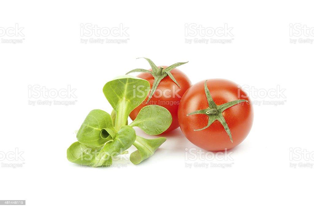 Valerianella locusta, corn salad, cherry tomato stock photo