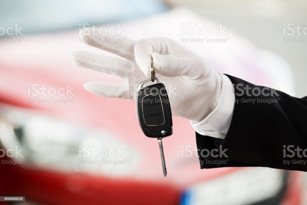 Valet Boy Hand Holding Car Key stock photo