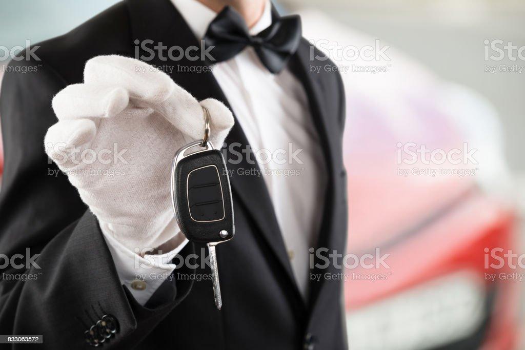 Valet Boy Holding A Car Key stock photo