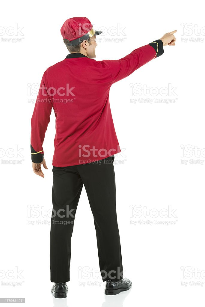 Valet standing with hand pointing royalty-free stock photo