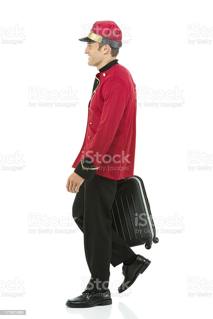 Valet walking with a suitcase royalty-free stock photo