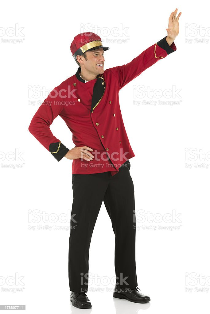 Valet waving his hand royalty-free stock photo