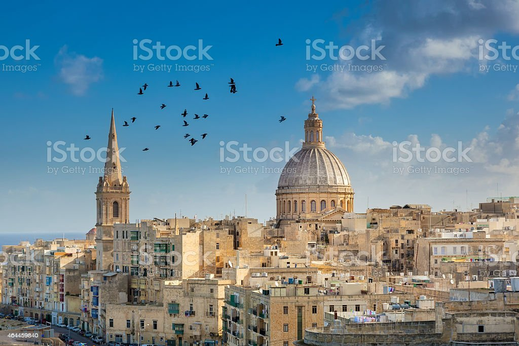 Valetta city buildings with birds flying stock photo
