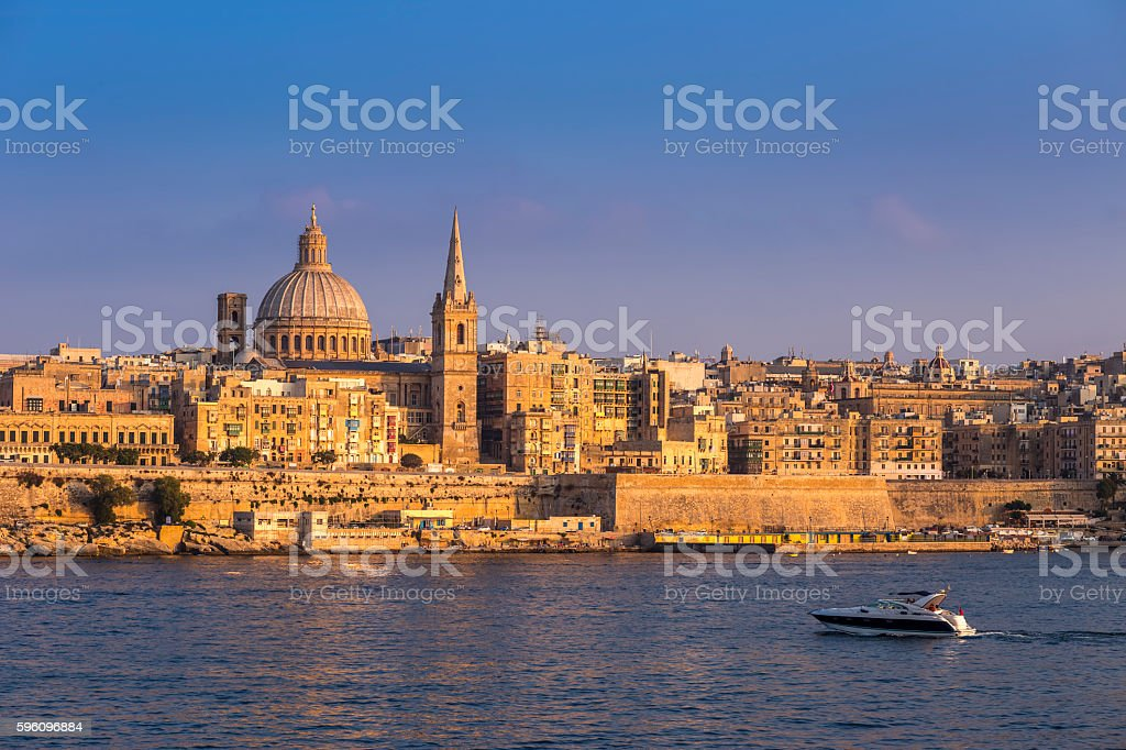 Valletta, Malta - Motorboat and the famous St.Paul's Cathedral royalty-free stock photo