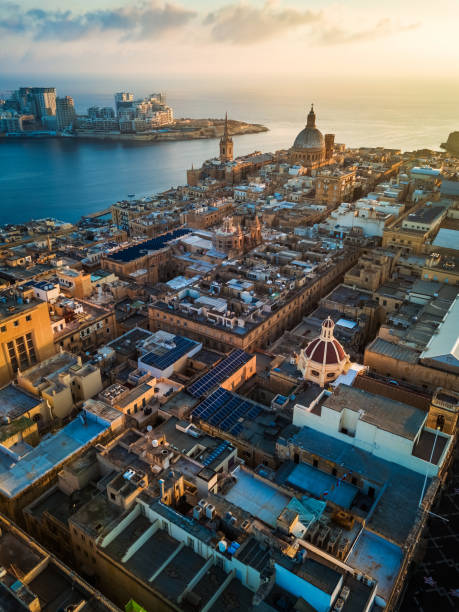 Valletta, Malta - Sunrise above Valletta with Our Lady of Mount Carmel church and St.Paul's Cathedral with Sliema stock photo