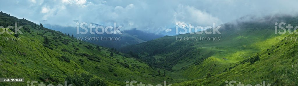 Valley between two mountain ranges stock photo