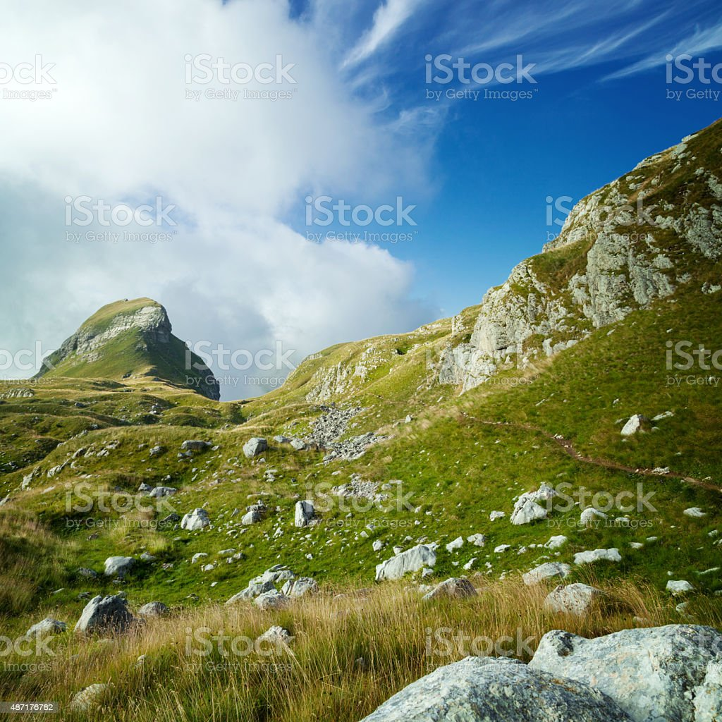 Valley in the mountains under the blue sky stock photo