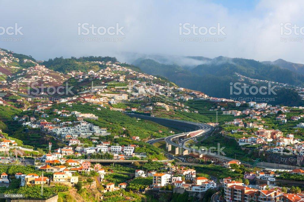 valley of Camara de Lobos in Madeira, Portugal. buildings, gardens and highway