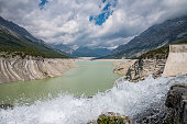 The dam and the lake in the valley of Fraele in the italian alps