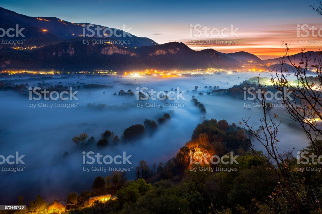 Valley of the Adda river during a foggy morning, Airuno, Italy stock photo