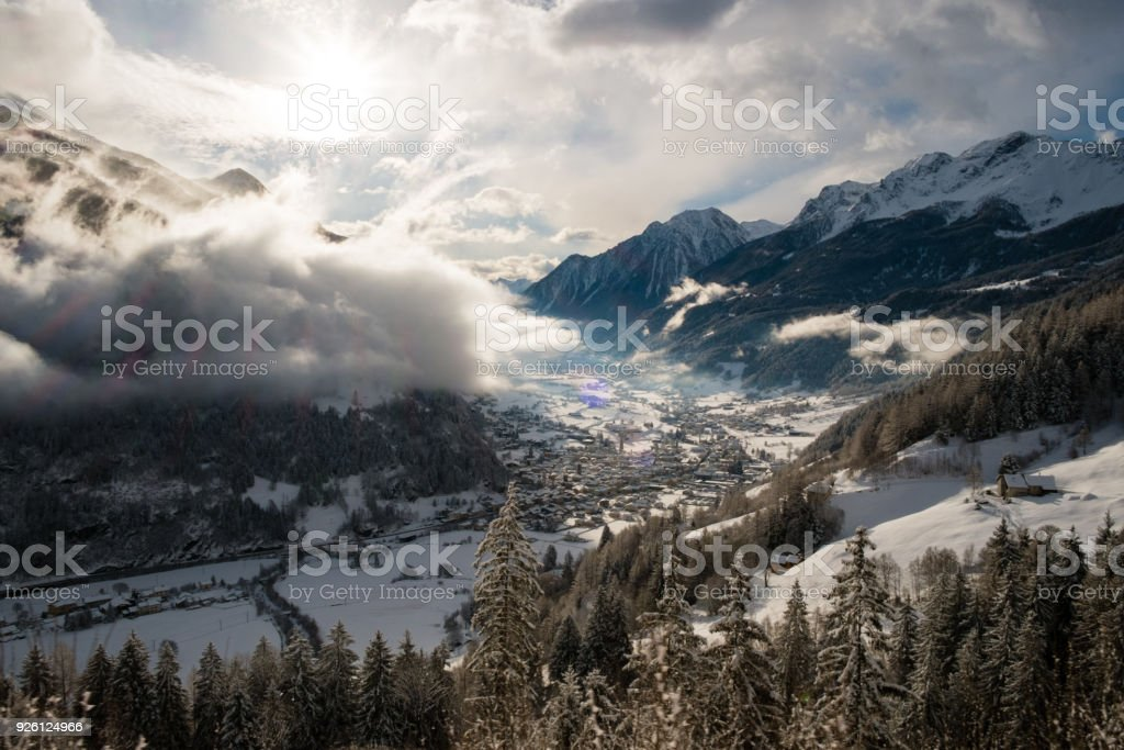 POSCHIAVO, SWITZERLAND - January, 2018. Valley of Val Poschiavo seen from above, from the train route Bernina Express, Unesco world heritage, in winter with snow stock photo