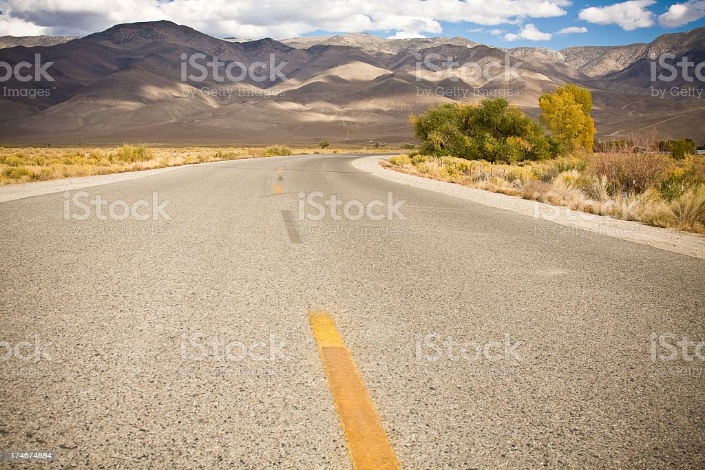 valley road into the mountains royalty-free stock photo