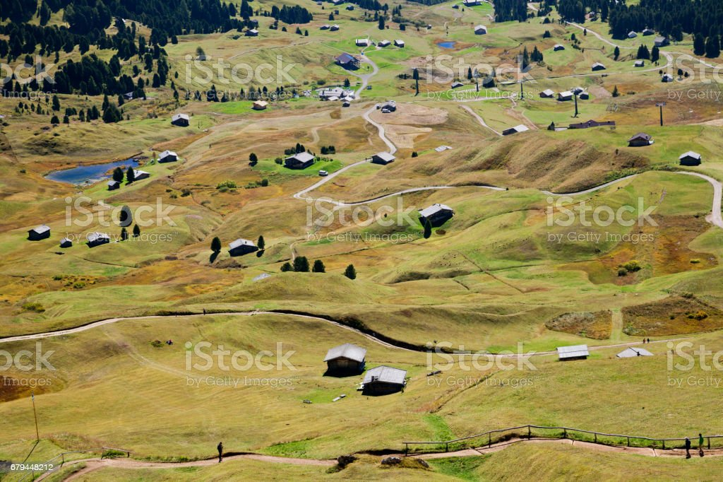 Valley with houses in Dolomite Alps stock photo