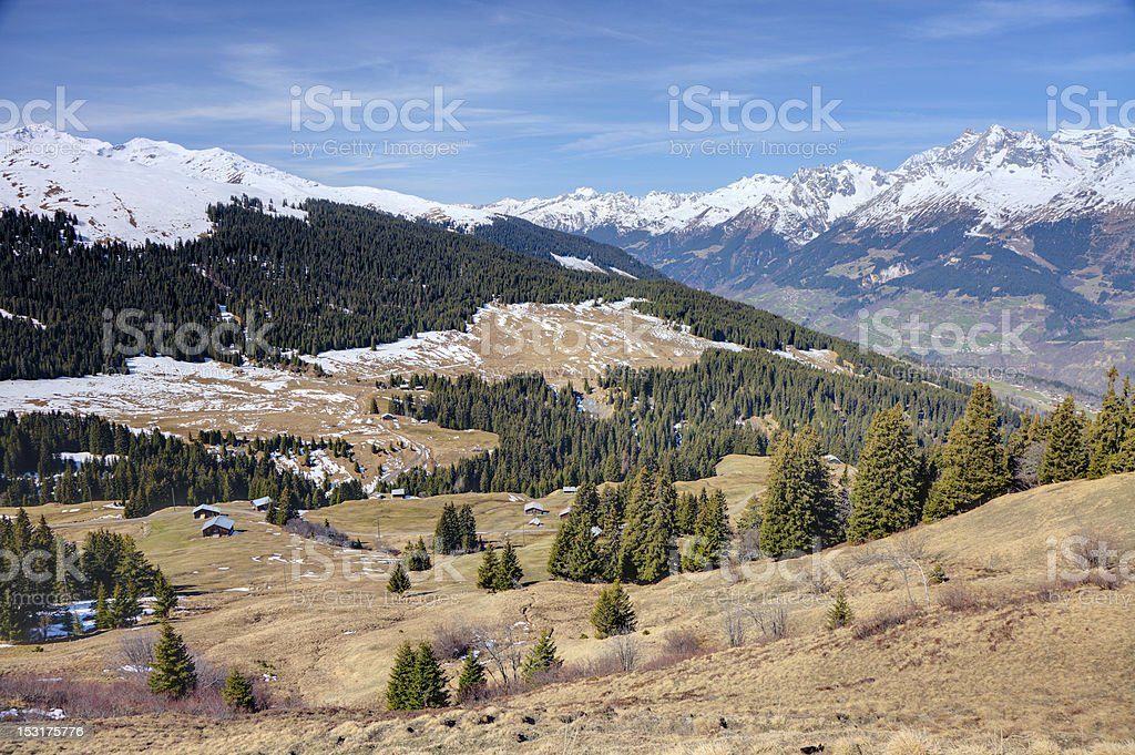 Valley with Huts in the Alps stock photo