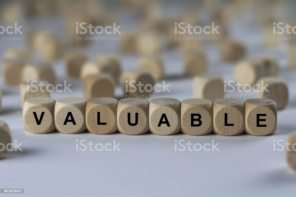 valuable - cube with letters, sign with wooden cubes stock photo