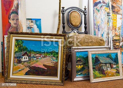 Collection of different types of handmade framed paintings in the workshop.