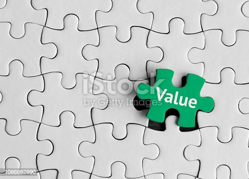 Puzzle pieces with word 'Value'.