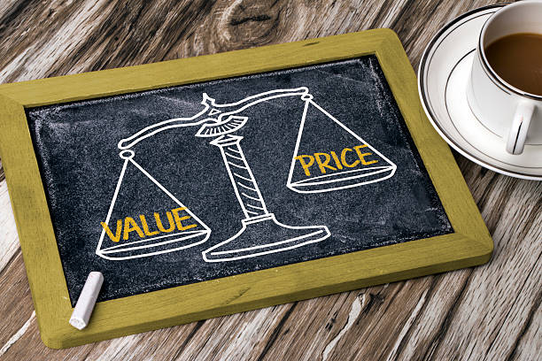 value price concept on balance scale stock photo