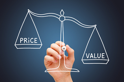 Hand drawing Value Price scale business concept with white marker on transparent wipe board on dark blue background. Big value, small price.