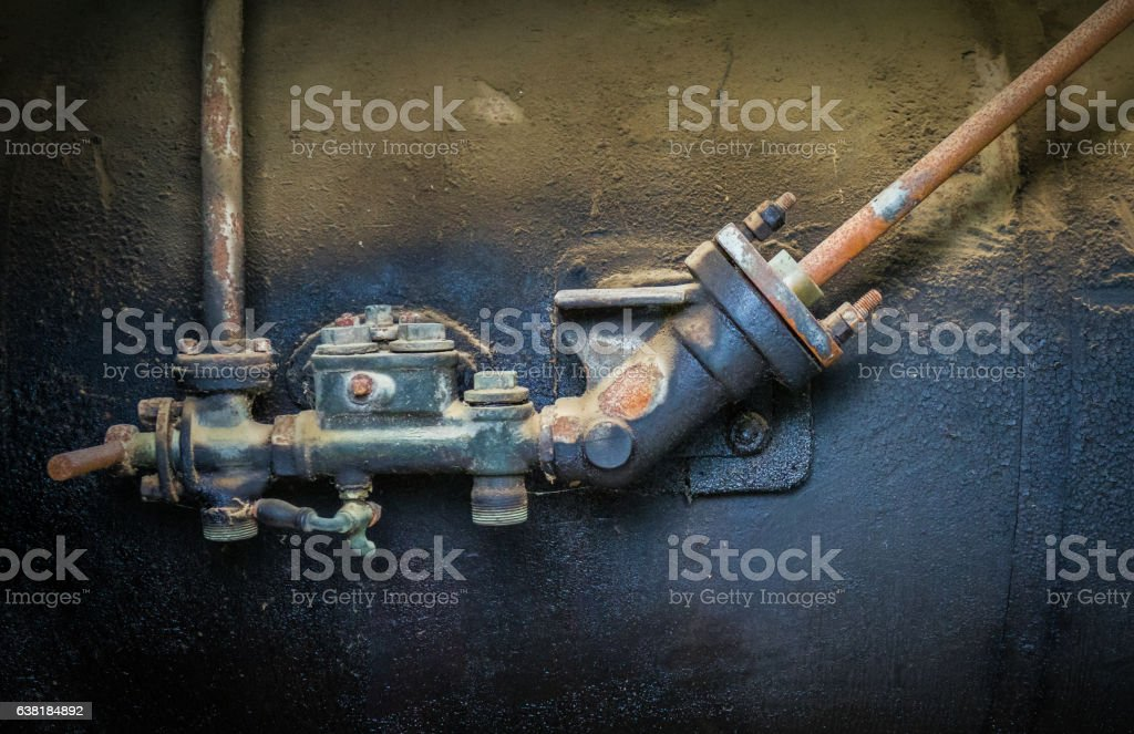 Valve of an old iron barrel with the chemical stock photo