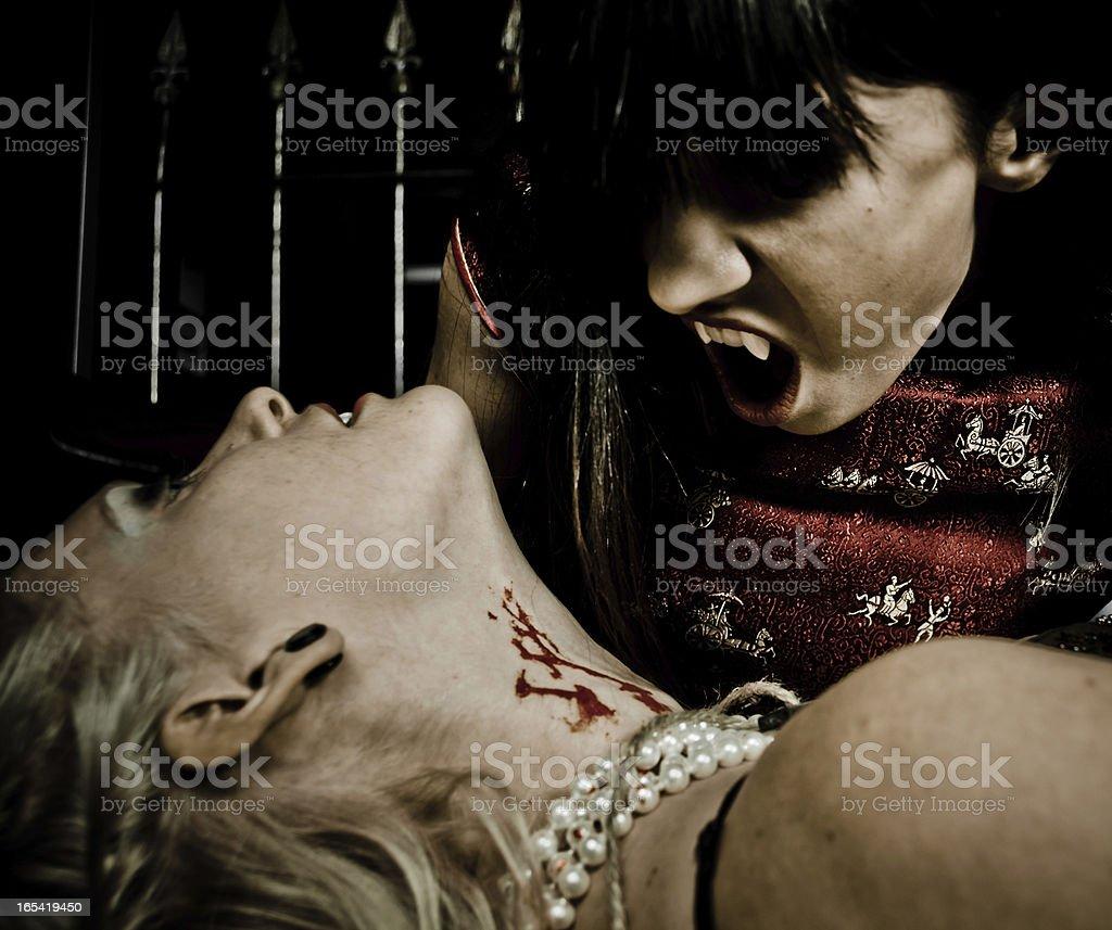Vampire Biting her Victim royalty-free stock photo