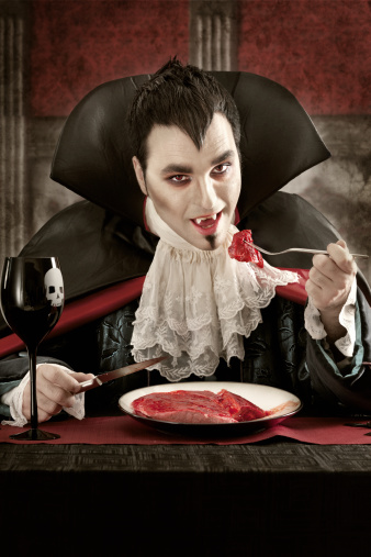 Vampire Eating Meat Stock Photo - Download Image Now - iStock