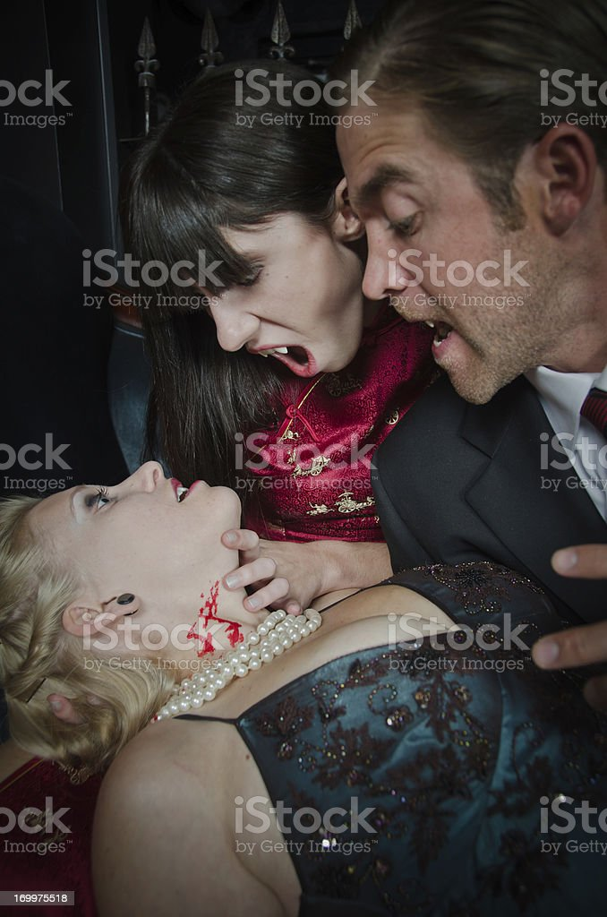 Vampire Feeding On A Young Woman royalty-free stock photo