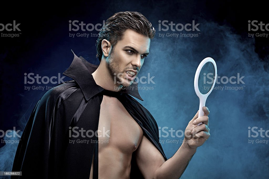 vampire looking at the mirror royalty-free stock photo