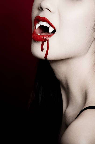 Vampire  fang stock pictures, royalty-free photos & images