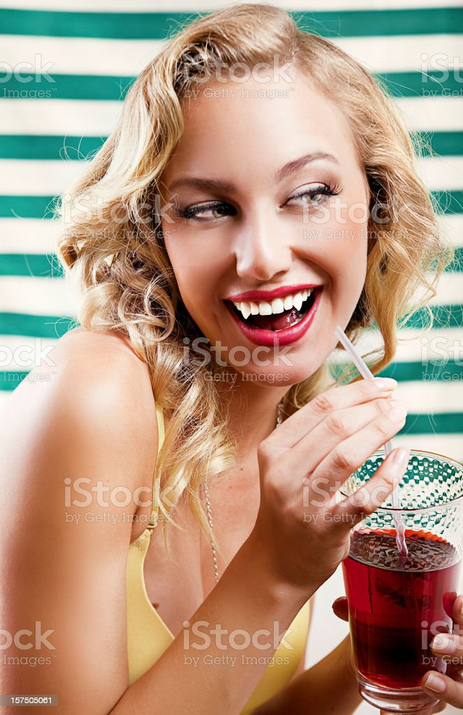Vampire pin up with bloody cocktail royalty-free stock photo