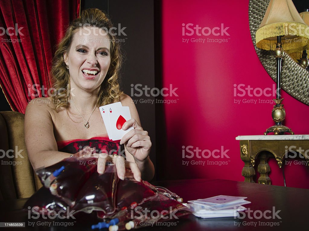 Vampire Playing Poker With Blood As Chips royalty-free stock photo