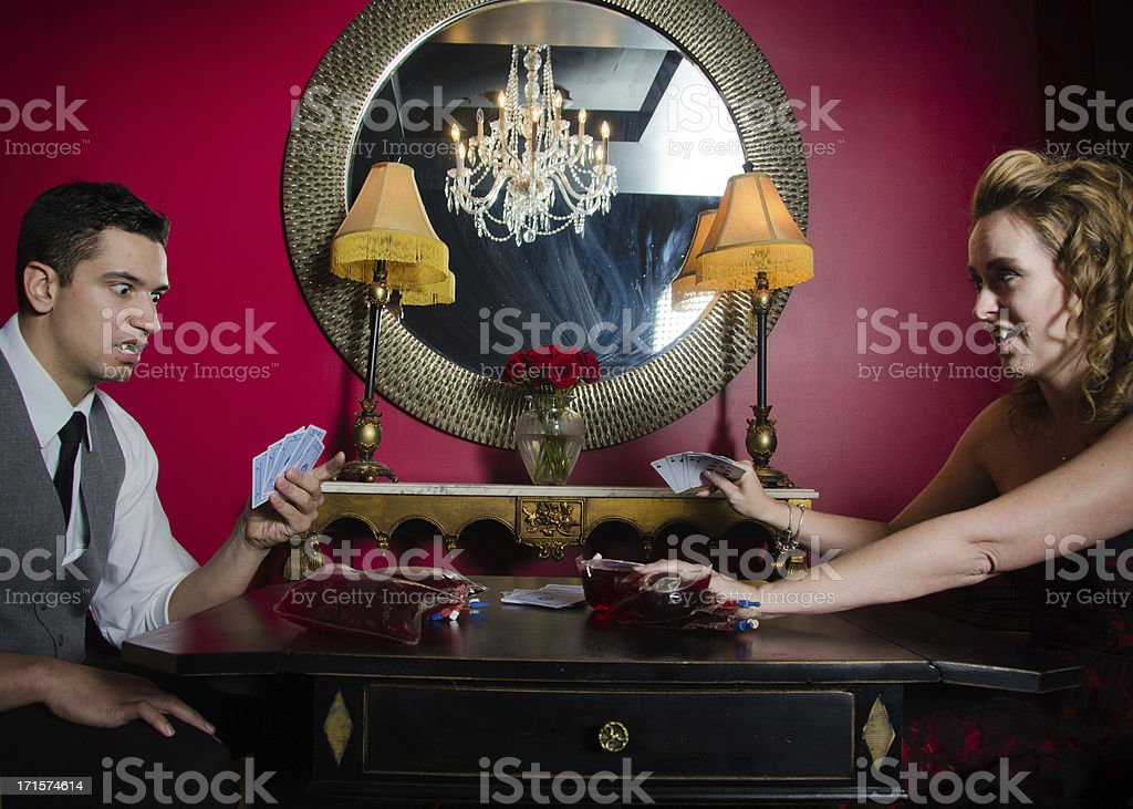 Vampire Poker Players Using Blood As Chips stock photo