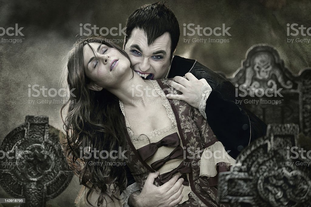 Vampire sucking blood from woman's neck royalty-free stock photo